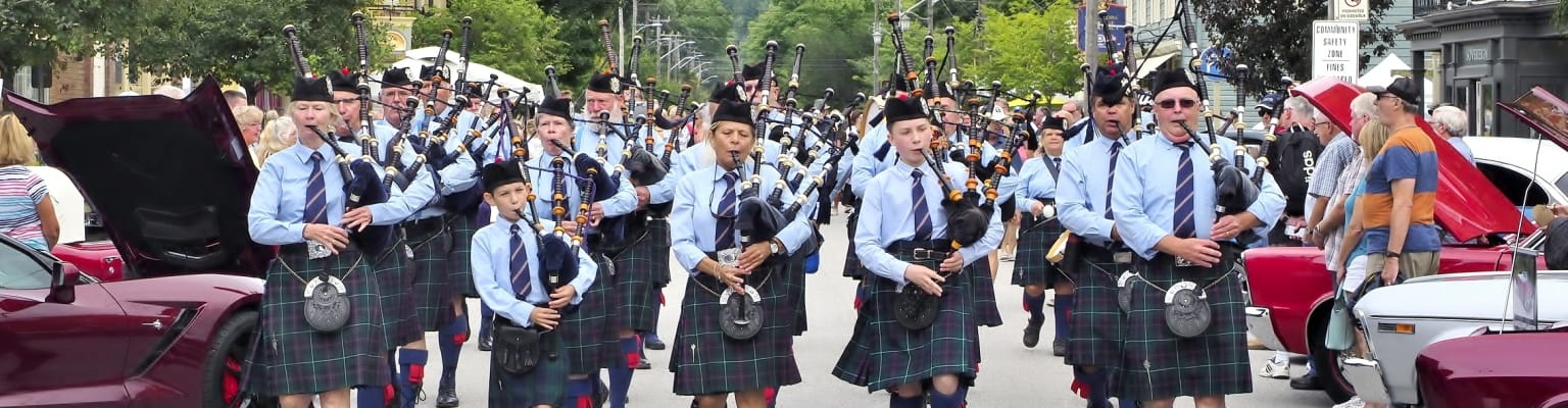 Pipe band marching in Creemore
